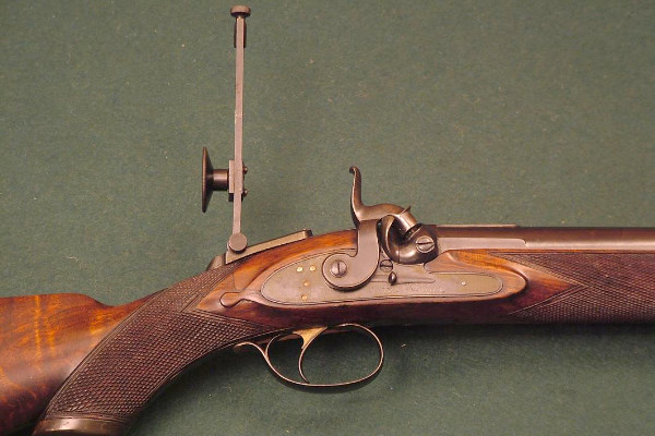 Rigby rifle shows the long range apature sight.