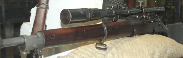 24 inch Barrel Springfield 1903 Rifle with a Scope nearly as long. WWII Sniper Version.